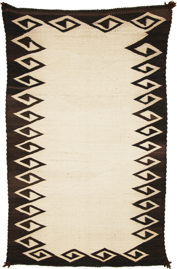 brown and white navajo double saddle blanket